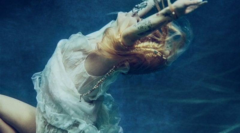 Avril Lavigne - water first image - head above water