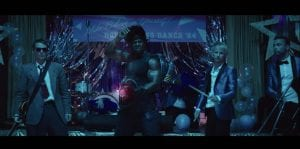 "Muse Recruits Terry Crews For Wild ""Pressure"" Music Video"