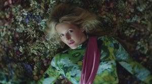 "Ellie Goulding Shows Off High Fashion In ""Close To Me"" Music Video"